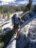 Mike navigates a narrow granite path off-trail