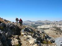 Tom and Jason round corner up to Post Peak Pass